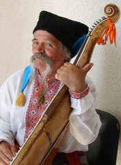 Senior ukrainian musician with bandura 18