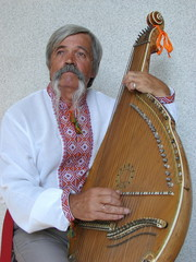 Senior ukrainian musician with bandura 17