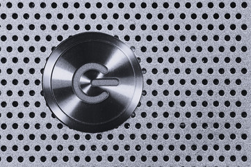 Power Button on Metal Hole Background.