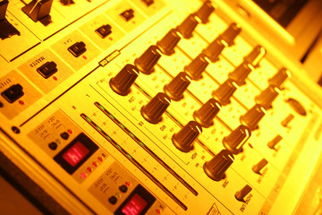 music mixer in yellow light for flyer