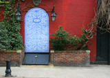 Antique entrance covered with blue decorated porcelain tiles poster
