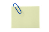 paper yellow sticker with clip over white poster