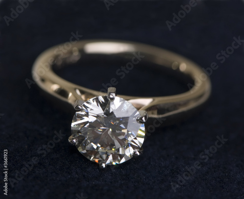 A very large diamond wedding ring on a black background