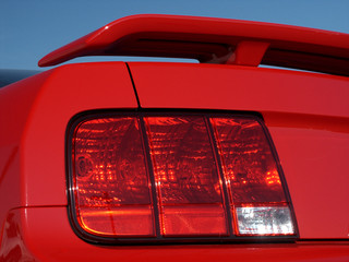 Taillight and spoiler on new red car
