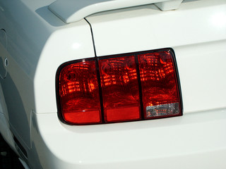 Taillight and spoiler on new white car