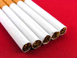 Cigarettes the filter. A close up on a red background.