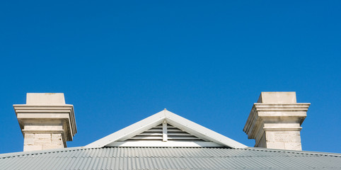 roof with tin and chimney with view to blue sky