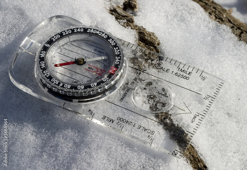 hiking compass in a snowy forest