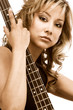 Latina blonde Girl sitting with bass guitar