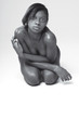 Scared naked young African-American female (BW)