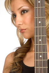Portrait of Attractive blonde Girl with guitar