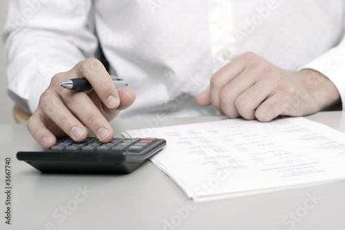 A businessman calculating expenses at tax time