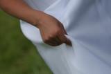 hand holding white dress gown elegant poster