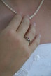 hand touching necklace ring jewelry pearl finger wedding