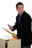 A man slipping documents out of a file cabinet a poster