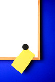 white-board with empty yellow post-it note poster