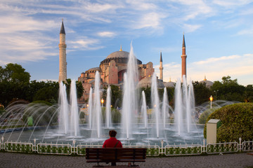 people sitting by the fountain near of Hagia Sophia in Istanbul