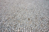 Cobblestone pavement, great for background and texture poster