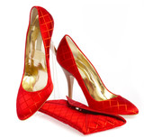 Female shoes and handbag on it is white a background poster
