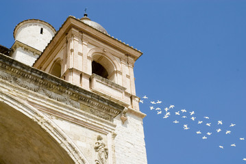 Basilica in Assisi with doves as a symbol of peace