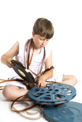 boy is winding up the celluloid movie
