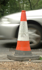 road safety cone and passing traffic