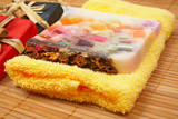 Gifts and fruits soap on bamboo mat. Shallow DOF