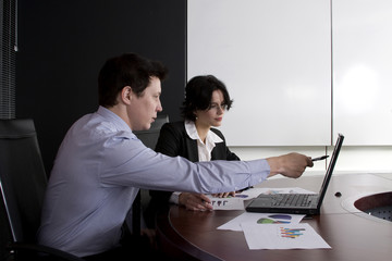 Business workgroup interacting in a boardroom setting