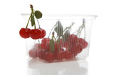 Fresh cherry in transparent packing on a white background poster