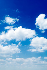 The white clouds on background blue sky.