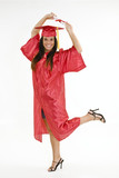 A female caucasian in red graduation gown and very excited.  poster