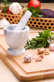 Cooking with culinary herbs, vegetables, mortar and pestle. poster