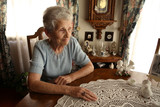 Elderly Senior Citizen Looking Out a Window in Contemplation poster