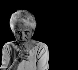 Stern Senior Citizen Pointing Her Finger and Reprimanding