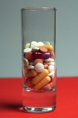 Glass full of pills