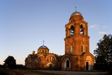 An old orthodox church by a summer evening on sunset poster