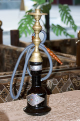 Hookah on a table in summer cafe