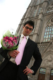 Nervous groom waiting for his bride at church. poster