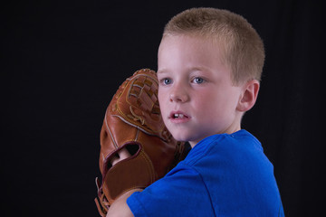 Little blond little league player ready to pitch the ball.