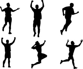silhouettes celebrating scoring goal in soccer match
