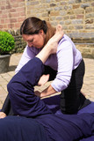 Massaging the hamstring as part of a Thai body massage. poster