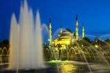 blue mosque in Istanbul and fountain at night poster