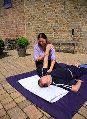Stretching of the shoulder as part of a Thai body massage.