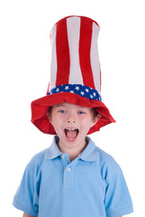 Young boy wearing a stars and stripes patriotic top hat