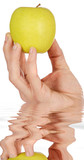 Apple in a hand low in calories a over white background poster