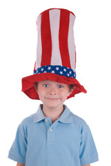 Young boy wearing a stars and stripes patriotic top hat.