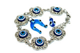 Metallic bracelet and medallions with blue eyes  poster