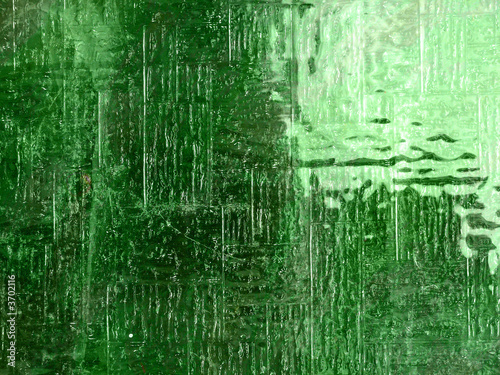 Glass level, texture in green, window with grainy surface