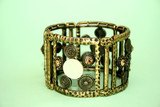 Metallic ancient style bracelet with ornaments and stones. poster