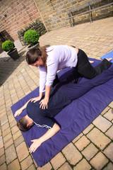 Shoulder blade massage as part of a Thai body massage.